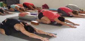Class in Adho Mukha Virasana